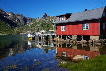 Fishing hut reflecting in fjord