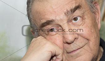 Portrait of the elderly man.