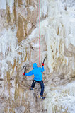 Young man climbing the ice