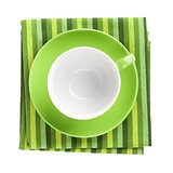 Green coffee cup over kitchen towel