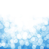 Blurred bokeh nature background with snow flakes