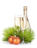 Champagne glasses, bottle, baubles and fir tree