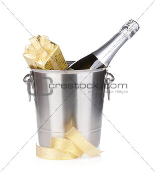 Champagne bottle in bucket and gift box