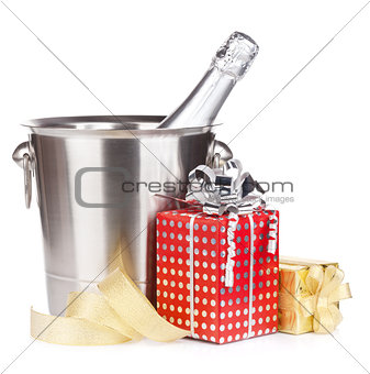 Champagne bottle in bucket and gift boxes