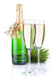 Champagne bottle, glasses and christmas decor