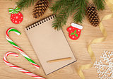 Christmas fir tree, blank notepad and decor