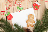 Christmas fir tree, gingerbread cookies and card for copy space