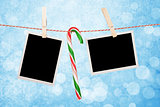 Blank photos hanging on clothesline