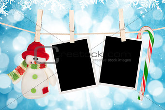 Blank photo frames and snowman hanging on the clothesline