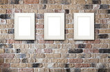 Photo frames on brick wall
