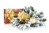 Gift boxes and christmas decor with snowy fir tree