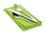 Silverware or flatware set of fork, spoon and knife on towel