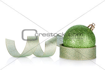 Green sparkling christmas bauble with ribbon