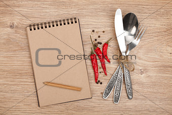 Blank notepad with pencil and silverware set