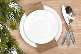 Empty plate, silverware set and christmas tree