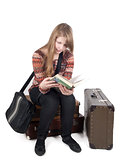 girl on suitcases