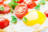 Fried eggs with cherry tomatoes