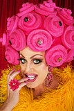 Grinning Drag Queen Biting Fingernails