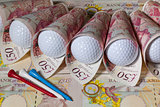 British pounds and golf balls