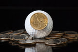 White golf ball and U.S. dollar coins