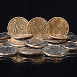 U.S. dollar coins on a table