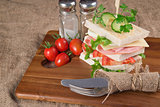 Fresh club sandwich in rustic kitchen setting