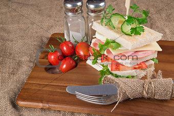 Fresh club sandwich in rustic kitchen setting