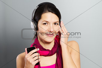 Beautiful trendy woman listening to music