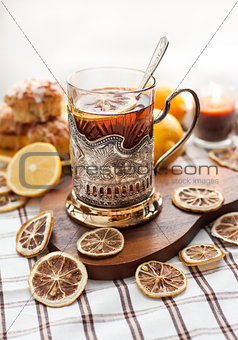 Black tea with lemon in the silver glass-holder