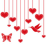 Red hearts hanging on a string