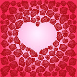 Heart of dark red roses on a pink background