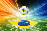 Soccer ball and flag of Brazil