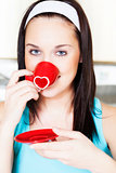 Woman drinking morning coffee - St. Valentine Day concept