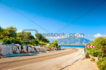 highway along the sea on a background of mountains