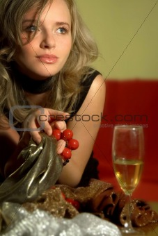 girl with beads and glass of wine