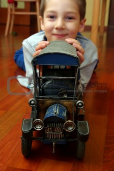 A child plays with the cars