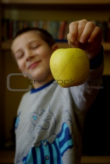 A child offers an apple