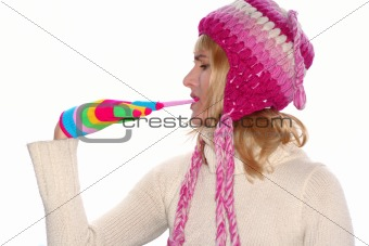 Blond girl in a pink cap remove glove