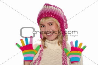 Smiling blond girl in cap and Multi-coloured gloves