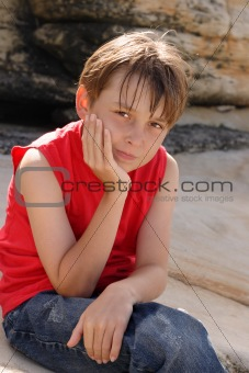 Child sitting on rocks