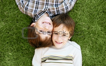 Boys Laying in the Grass