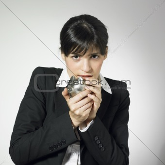 businesswoman hugging piggy bank