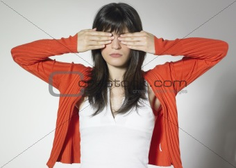 woman cover eyes with hands