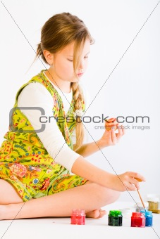 Girl painting easter eggs
