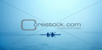 Couple canoeing in the morning