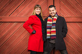 Mixed Race Couple Portrait in Winter Clothing Against Barn Door