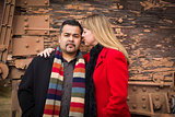 Mixed Race Couple Portrait in Winter Clothing Against Rustic Tra