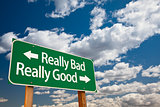Really Bad, Really Good Green Road Sign and Clouds