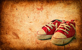Baby sneakers on grunge paper