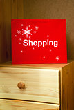 Red Christmas Shopping bag on wooden drawer